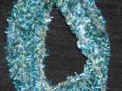 A demonstration of the mathematical basis of crochet: a scarf made as a moebius strip. Acrylic with novelty yarn. Original design.