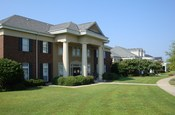 English: The University of South Carolina Greek Village is the home of 20 sorority and fraternity houses.