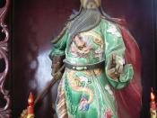 A Guan Yu statue holding the guan dao in the right hand.