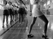 English: Tap dancing class in the gymnasium at Iowa State College. Ames, Iowa.
