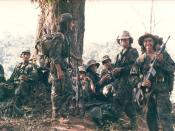 ARDE Frente Sur Commandos take a smoke break after routing FSLN base at El Serrano. Southeast Nicaragua 1987.