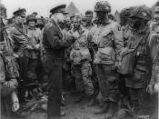 General Eisenhower speaks with members of the 101st Airborne Division on the evening of 5 June 1944