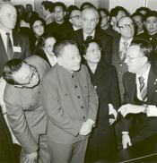 English: Deng Xiaoping, Vice Premier of the People's Republic of China state council, and his wife are briefed by Johnson Space Center director Dr. Christopher C. Kraft. A complete review of NASA's manned space program was given, using exhibit scale model