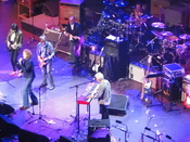 English: Faces at a reunion concert, Royal Albert Hall, London, October 2009. Pictured are Ronnie Wood, Mick Hucknall, Bill Wyman, Andy Fairweather-Low, Ian McLagan and Kenney Jones on drums.