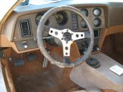 1974 Bricklin SV-1 sports car - interior view of dashboard. Standard American Motors (AMC) powertrain including the 360 CID (5.9 L) V8 engine and four-speed manual transmission.