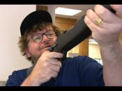 Michael Moore upon receiving his free gun at the bank.