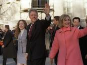 US President Bill Clinton (center with hand up), first lady Hillary Rodham Clinton to right of photo; their daughter Chelsea Clinton to left. On procession in public. The President, First Lady, and Chelsea on parade down Pennsylvannia Avenue on Inaugurati
