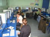 Internet training taking place in an public internet access point in a gmina.
