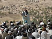A mullah of Day Kundi speaks to a crowd of villagers on the final day of Ramadan in the province of Day Kundi, Afghanistan, Sept. 20. Photo by 55th Combat Camera