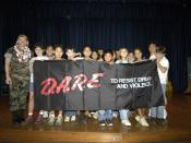 English: Pearl Harbor, Hawaii (May 31, 2005) – Master-at-Arms 1st Class Stacey Carfley stands with her recent class of Drug Abuse Resistance Education (D.A.R.E.) program graduates at Pearl Harbor Elementary School. Seventy-eight students graduated f