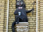 English: A sculpture of the cat Behemoth from the novel The Master and Margarita, on a wall in Andriyivskyy Descent, Kyiv. Français : Cat Béhémot, personnage de