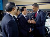 English: President Barack Obama talks with Chinese President Hu Jintao during the morning plenary session of the G-20 Pittsburgh Summit at the David L. Lawrence Convention Center in Pittsburgh.