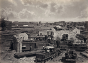 Atlanta, Georgia shortly after the end of the American Civil War showing the city's railroad roundhouse in ruins. Albumen print.