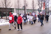 English: Members of the Service Employees International Union march towards the Wisconsin State Capitol in protest of Governor Scott Walker's collective bargaining restriction on unions.