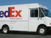 English: A FedEx Express delivery truck in a shopping center parking lot in Redwood City.