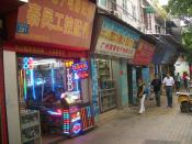 English: Electronic components shops in Guangzhou. The one in front is specializing in LEDs. There is a whole area - several blocks not far from the Guangta Mosque - mostly taken over by these shops. They, apparently, supply local companies that assemble