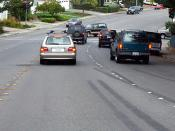 Botts' dots replace the painted median stripes. Reflective Stimsonite (darker orange) markers are spaced at regular intervals for increased visibility at night.