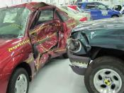 Crash test between a 1996 Ford Explorer and 2000 Ford Focus photographed at the Insurance Institute for Highway Safety Vehicle Research Center. Category:Ford_Focus_NA_Gen._I Category:Ford_Explorer_(second_generation) Category:Crash tests