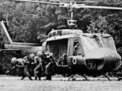 English: A U.S. Army rifle squad from the Blue Team of the 1st Squadron, 9th Cavalry exiting from a Bell UH-1D Huey helicopter in Vietnam. The 1st Squadron, 9th Cavalry Regiment was the air cavalry reconnaissance squadron of the 1st Cavalry Division throu