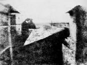 View from the Window at Le Gras, the first successful permanent photograph created by Nicéphore Niépce in 1826 or 1827, in Saint-Loup-de-Varennes. Captured on 20 × 25 cm oil-treated bitumen. Due to the 8-hour exposure, the buildings are illuminated