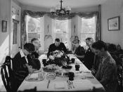 English: Saying grace before carving the turkey at Thanksgiving dinner in the home of Earle Landis in Neffsville, Pennsylvania