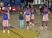 Harlem Globetrotters, are playing with a spectator during a game