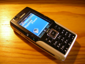 English: Siemens SXG75 mobile phone, Metallic Black version. The icons on the uppper status bar on the display have been changed from the original orange to blue, via software modding.