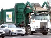 A standard Waste Management Inc. front-loading garbage truck in San Jose, California