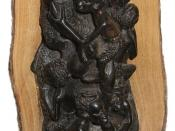 In this ebony sculpture, the artist has made use of the contrasting colors and textures in a single piece of wood.