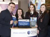Dr Stephen Farry at UCAS Higher Education Convention with Careers Adviser, Bernie O'Brien, and Wallace High School pupils, Kelly McComb and Rhyanna Hunter