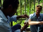 Solomon Water volunteer and his counterpart Josh Torenn test for particles in Honiara's main water supply at the Kongulai water source.