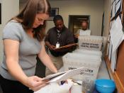 English: MILLINGTON, Tenn. (May 18, 2010) Shaunna Brooks, left, Anthony Anderson and Jim Murray, customer service center agents, sort through selection board packages at Navy Personnel Command. The center has processed 40,000 selection board packages duri