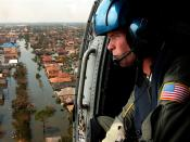 A U.S. Coast Guardsman searches for survivors in New Orleans in the aftermath of Hurricane Katrina