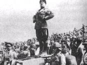 Il Duce standing on top of a tank.