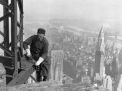Photograph of a Workman on the Framework of the Empire State Building. Many structural workers are above middle-age.