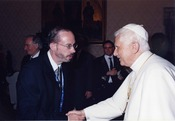 John L. Allen, Jr. with Pope Benedict XVI. John Allen is multi-awarded journalist, who is known for his objectivity. He is a vaticanista, i.e. a journalist specializing on Vatican affairs.