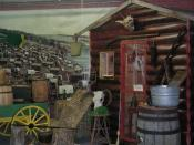 English: Image of a replica of what a house on the American western frontier might have looked like on display at the Museum of World Treasures in Wichita, KS.