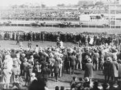 English: Phar Lap winning the Melbourne Cup Race from Second Wind and Shadow King on 5th November, 1930. Shows horses going over the finishing line viewed from over the heads of the crowd.