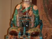 Chinese glazed stoneware statue of a Daoist deity, from the Ming Dynasty, 16th century.
