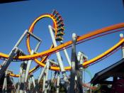 English: The Silver Bullet Coaster at Knotts Berry Farm going through a loop and people going upside down