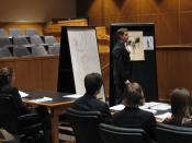 English: A student delivers a closing argument during a mock trial competition.