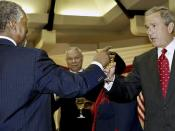 U.S. president Bush and South African president Mbeki, touching glasses during the former's visit to South Africa and other African countries, July 2003.