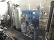 English: A custom-built 1000 liter reverse osmosis water purification plant for commercial use.