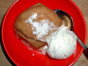 an apple dumpling with vanilla ice cream