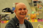 English: Nick Hornby signing books at Central Library, Seattle, Washington.