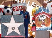 English: Charles M. Schulz receives his star on the Hollywood Walk of Fame in a ceremony at Knott's Berry Farm in Buena Park. Marion Knott stands between Schulz and Snoopy.