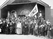 Maori group in the porch at the opening of the large two-storied Parliament house of the Kotahitanga movement at Pāpāwai, Greytown, New Zealand; Richard John Seddon stands to the left of the group. 1897. Pāpāwai was the seat of the Maori Parliament in the