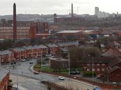 A view over Broadway in Chadderton, towards Werneth and Oldham, all in Greater Manchester, England. Raven Mill off to the left, with Nile & Chadderton Mills behind. Centre is the hulk of Hartford Mill. Also visible is Anchor Mill in Westwood, Oldham. On t