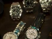 Counterfeit Rolex watches were displayed at the dedication and open house of the National Intellectual Property Rights Coordination Center in Arlington, VA.