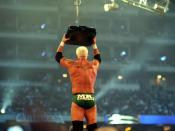Mr. Kennedy retrieving the Money in the Bank briefcase